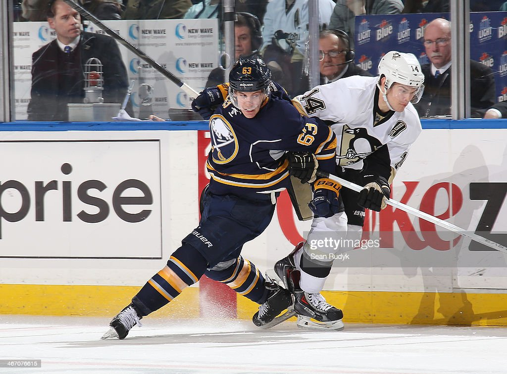 Tyler Ennis #63 of the Buffalo Sabres gets tied up while battling for position against <a gi-track='captionPersonalityLinkClicked' href=/galleries/search?phrase=Chris+Kunitz&family=editorial&specificpeople=604159 ng-click='$event.stopPropagation()'>Chris Kunitz</a> #14 of the Pittsburgh Penguins at First Niagara Center on February 5, 2014 in Buffalo, New York.