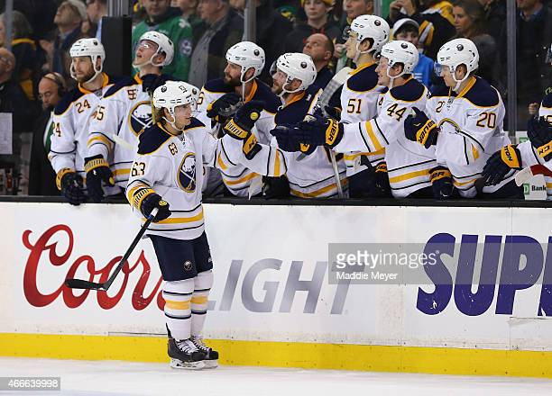 Tyler Ennis of the Buffalo Sabres is congratulated by his teammates after scoring a goal against the Boston Bruins during a shootout at TD Garden on...