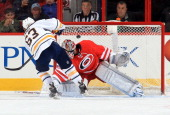 Tyler Ennis of the Buffalo Sabres scores against Cam Ward of the Carolina Hurricanes on a penalty shot during their NHL game at PNC Arena on March 13...