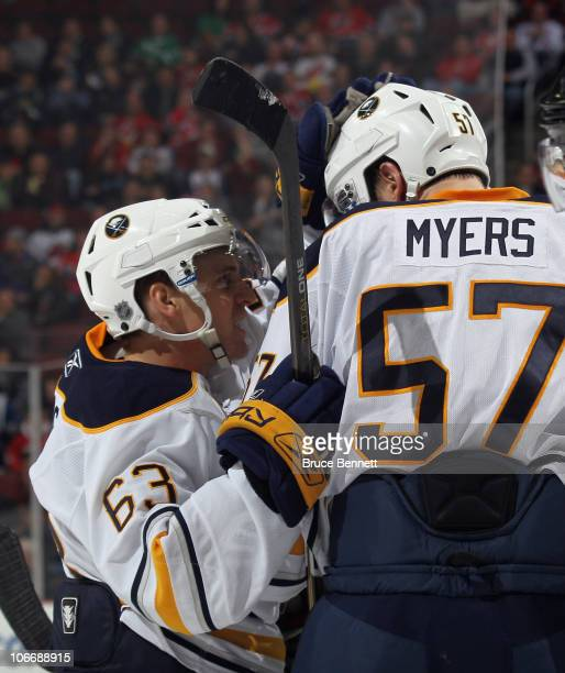 Tyler Ennis of the Buffalo Sabres scores at 854 of the third period and celebrates with Tyler Myers in their game against the New Jersey Devils at...