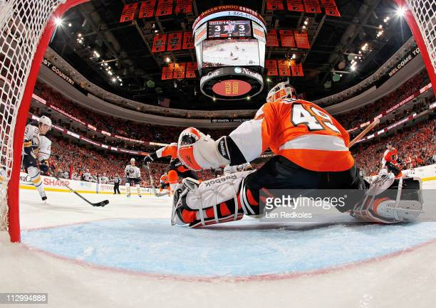 Tyler Ennis of the Buffalo Sabres scores the game winning goal in overtime against Michael Leighton of the Philadelphia Flyers in Game Five of the...