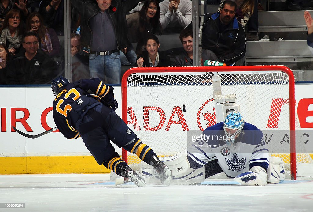 Tyler Ennis #63 of the Buffalo Sabres scores the shoot out winner against <a gi-track='captionPersonalityLinkClicked' href=/galleries/search?phrase=Jean-Sebastien+Giguere&family=editorial&specificpeople=202814 ng-click='$event.stopPropagation()'>Jean-Sebastien Giguere</a> #35 of the Toronto Maple Leafs at the Air Canada Centre on November 6, 2010 in Toronto, Canada. The Sabres defeated the Maple Leafs 3-2.