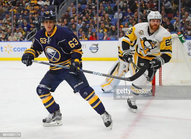 Tyler Ennis of the Buffalo Sabres skates against Ian Cole of the Pittsburgh Penguins during an NHL game at the KeyBank Center on March 21 2017 in...