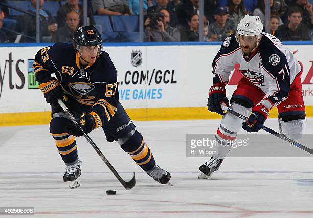 Tyler Ennis of the Buffalo Sabres skates with the puck against Nick Foligno of the Columbus Blue Jackets on October 12 2015 at the First Niagara...