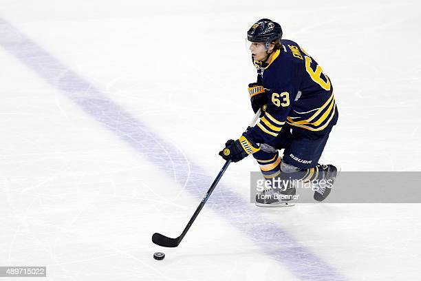 Tyler Ennis of the Buffalo Sabres skates with the puck during a game against the Ottawa Senators at the First Niagara Center on September 23 2015 in...