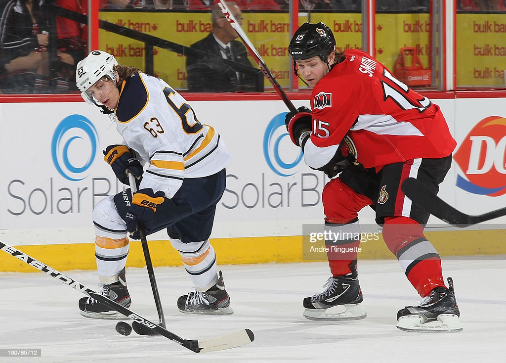 Tyler Ennis #63 of the Buffalo Sabres stickhandles the puck against Zack Smith #15 of the Ottawa Senators on February 5, 2013 at Scotiabank Place in Ottawa, Ontario, Canada.