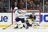 Tyler Ennis of the Buffalo Sabres takes a shot on goal against Niklas Svedberg of the Boston Bruins during a shootout at TD Garden on March 17 2015...