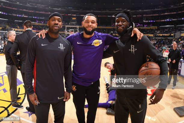 Tyler Ennis of the Los Angeles Lakers Bobby Brown and Briante Weber of the Houston Rockets pose for a photo before the game on December 3 2017 at...