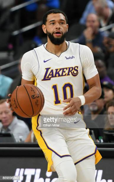 Tyler Ennis of the Los Angeles Lakers brings the ball up the court against the Sacramento Kings during their preseason game at TMobile Arena on...