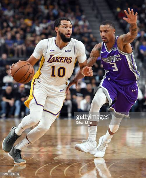 Tyler Ennis of the Los Angeles Lakers drives against George Hill of the Sacramento Kings during their preseason game at TMobile Arena on October 8...