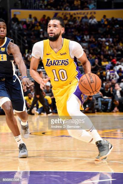 Tyler Ennis of the Los Angeles Lakers drives to the basket during the game against the Denver Nuggets during a preseason game on October 2 2017 at...