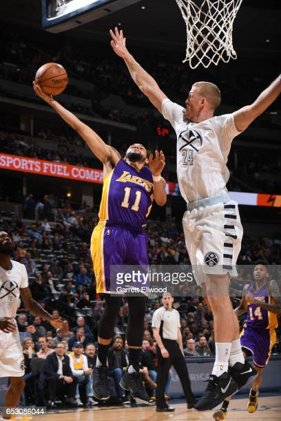 Tyler Ennis of the Los Angeles Lakers goes up for a shot against Mason Plumlee of the Denver Nuggets during a game on March 13 2017 at the Pepsi...