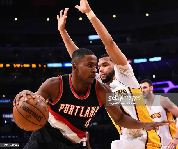 Tyler Ennis of the Los Angeles Lakers guards Maurice Harkless of the Portland Trail Blazers as he drives to the basket in the second half of the game...