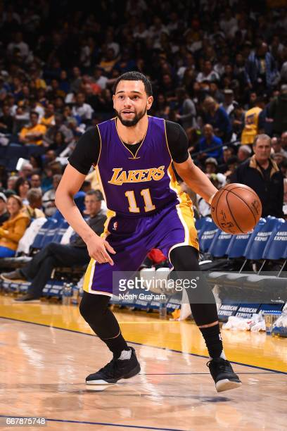 Tyler Ennis of the Los Angeles Lakers handles the ball against the Golden State Warriors on April 12 2017 at ORACLE Arena in Oakland California NOTE...