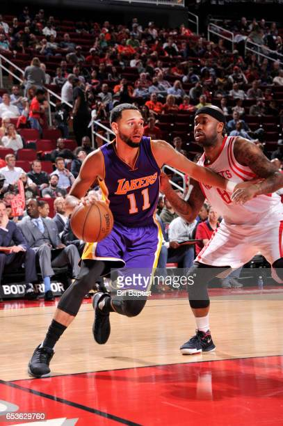 Tyler Ennis of the Los Angeles Lakers handles the ball during a game against the Houston Rockets on March 15 2017 at the Toyota Center in Houston...