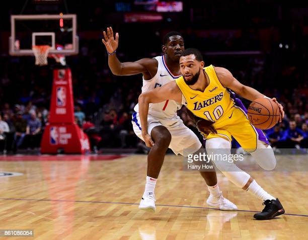 Tyler Ennis of the Los Angeles Lakers is called for an offensive foul as he drives on Jawun Evans of the LA Clippers during the first half at Staples...