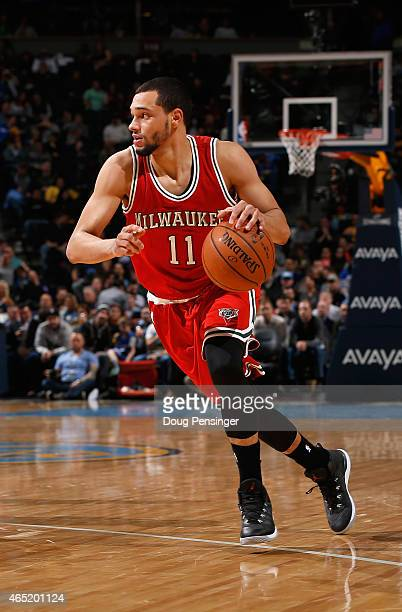 Tyler Ennis of the Milwaukee Bucks controls the ball against the Denver Nuggets at Pepsi Center on March 3 2015 in Denver Colorado The Nuggets...