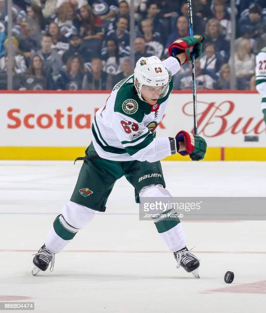 Tyler Ennis of the Minnesota Wild gets set to take a shot on goal during first period action against the Winnipeg Jets at the Bell MTS Place on...
