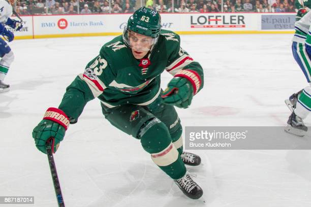 Tyler Ennis of the Minnesota Wild skates to the puck against the Vancouver Canucks during the game at the Xcel Energy Center on October 24 2017 in St...