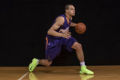 Tyler Ennis of the Phoenix Suns poses for a portrait during the 2014 NBA rookie photo shoot at MSG Training Center on August 3 2014 in Tarrytown New...