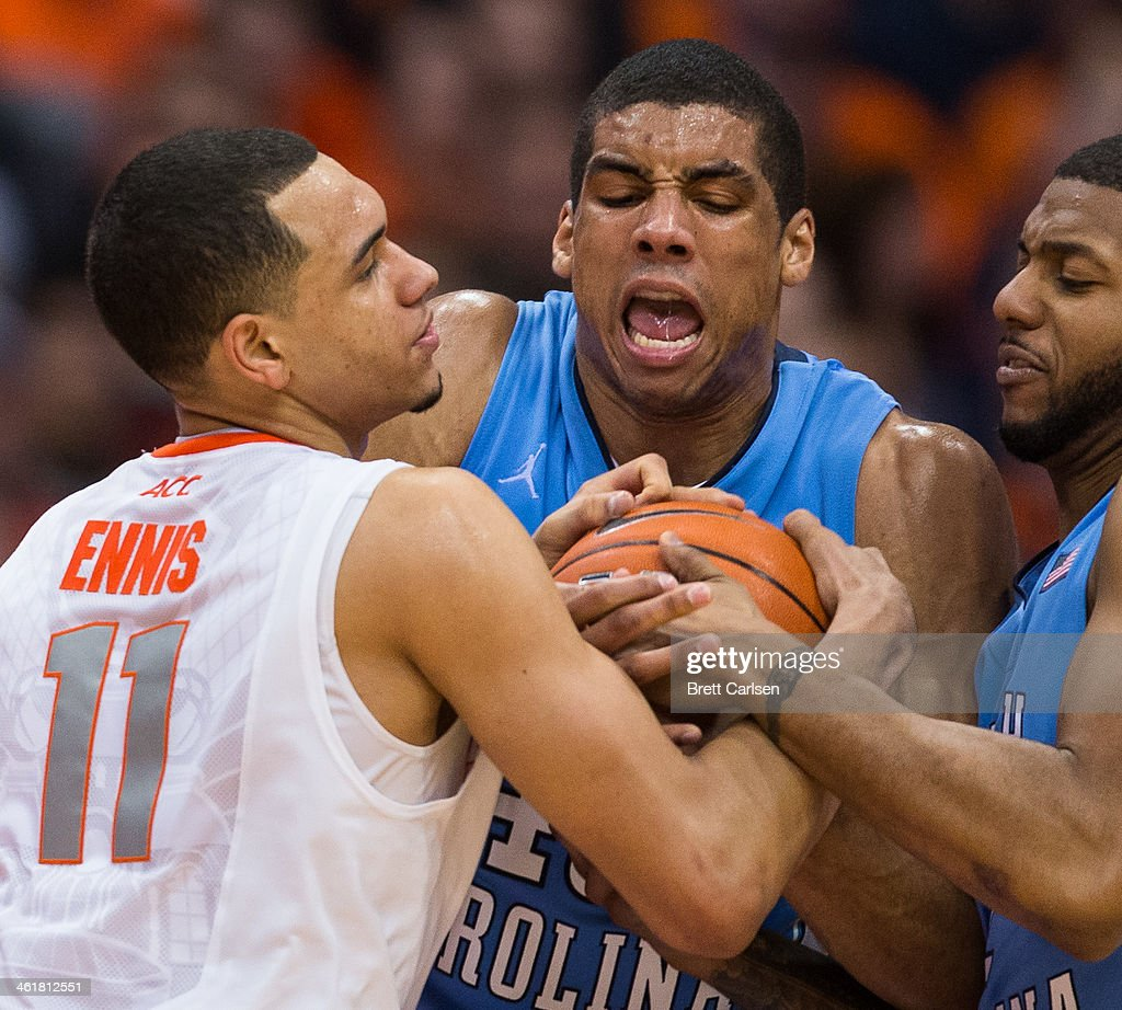 Tyler Ennis #11 of the Syracuse Orange battles with <a gi-track='captionPersonalityLinkClicked' href=/galleries/search?phrase=James+Michael+McAdoo&family=editorial&specificpeople=7908952 ng-click='$event.stopPropagation()'>James Michael McAdoo</a> #43 and Leslie McDonald #2 of the North Carolina Tar Heels for a loose ball in the second half on January 11, 2014 at The Carrier Dome in Syracuse, New York. Syracuse defeats North Carolina 57-45.