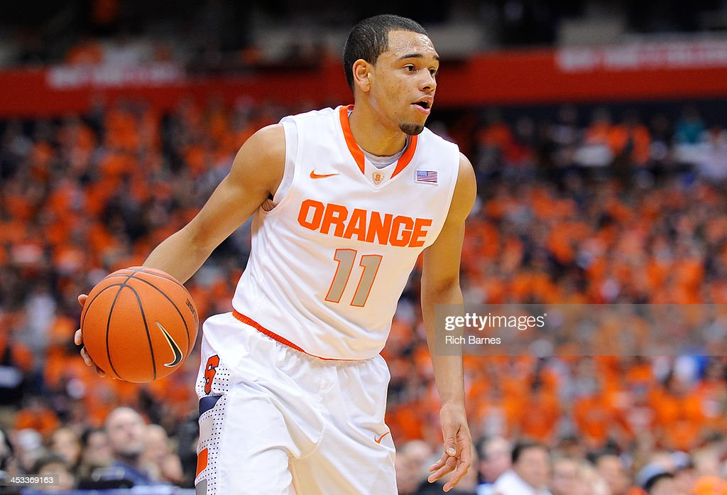 Tyler Ennis #11 of the Syracuse Orange scans the court against the Indiana Hoosiers during the first half at the Carrier Dome on December 3, 2013 in Syracuse, New York. Syracuse defeated Indiana 69-52.