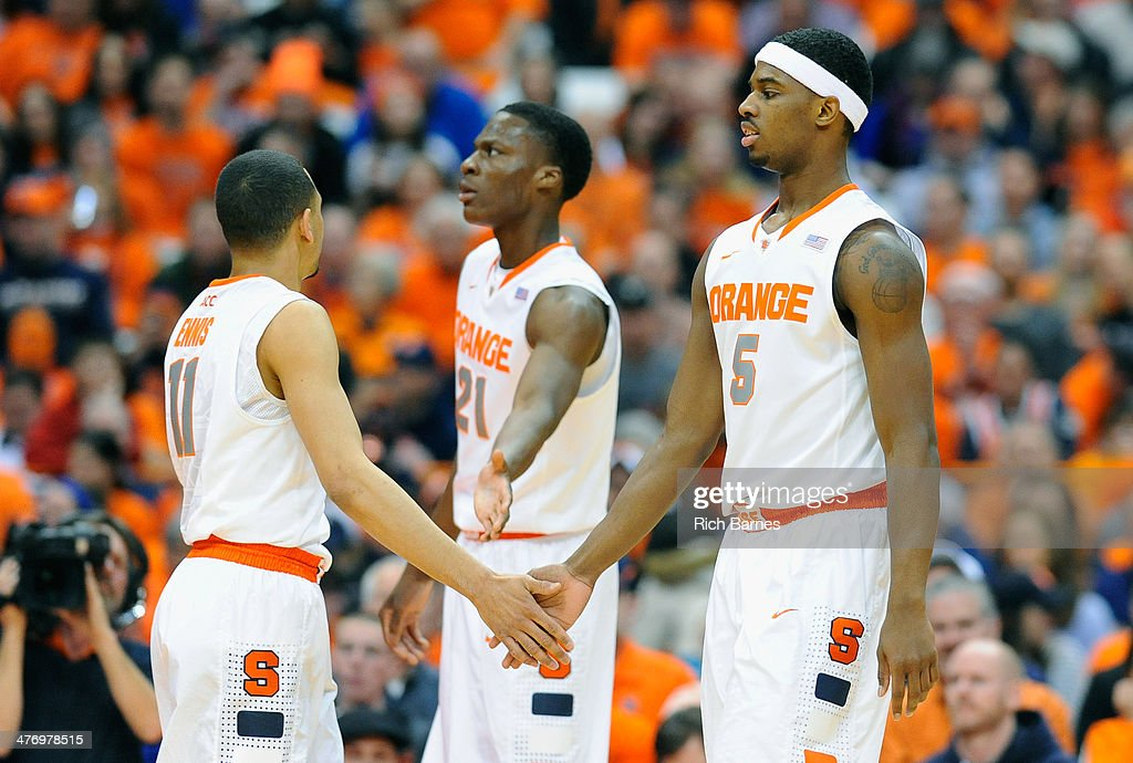 Tyler Ennis #11, Tyler Roberson #21 and <a gi-track='captionPersonalityLinkClicked' href=/galleries/search?phrase=C.J.+Fair&family=editorial&specificpeople=7366451 ng-click='$event.stopPropagation()'>C.J. Fair</a> #5 of the Syracuse Orange react to a play against the Georgia Tech Yellow Jackets during the first half at the Carrier Dome on March 4, 2014 in Syracuse, New York. Georgia Tech defeated Syracuse 67-62.