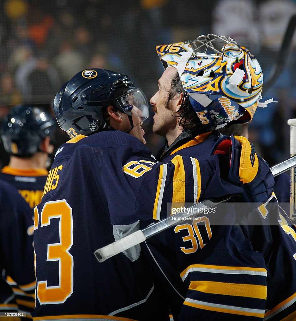 Tyler Ennis #63 who scored in the shootout celebrates a 3-2 victory with Ryan Miller #30 of the Buffalo Sabres against the Los Angeles Kings at the First Niagara Center on November 12, 2013 in Buffalo, New York.