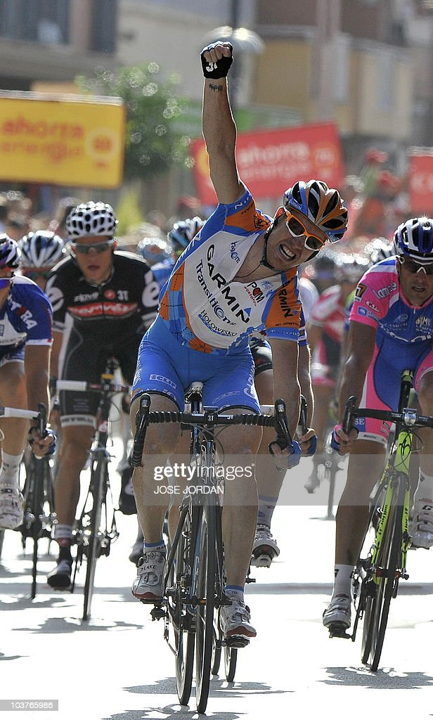 US Tyler Farrar of the Garmin-Transitions team celebrates as he crosses the finish line of the five stage of the Vuelta tour of Spain in Lorca on September 01, 2010.The stage was a 198,8 km course from team Guadix to Lorca.