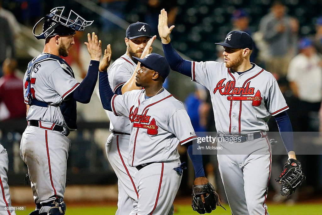 Tyler Flowers #25, Jim Johnson #53, Adonis Garcia #13 and Freddie Freeman #5 of the Atlanta Braves celebrate after defeating the New York Mets at Citi Field on September 19, 2016 in the Flushing neighborhood of the Queens borough of New York City.