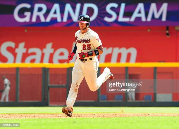 Tyler Flowers of the Atlanta Braves rounds the bases after hitting a fifth inning grand slam against the Cincinnati Reds at SunTrust Park on August...