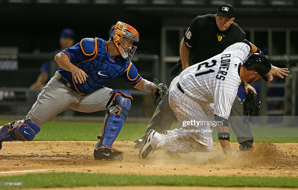 <a gi-track='captionPersonalityLinkClicked' href=/galleries/search?phrase=Tyler+Flowers&family=editorial&specificpeople=4217244 ng-click='$event.stopPropagation()'>Tyler Flowers</a> #21 of the Chicago White Sox beats the tag of <a gi-track='captionPersonalityLinkClicked' href=/galleries/search?phrase=John+Buck&family=editorial&specificpeople=213730 ng-click='$event.stopPropagation()'>John Buck</a> #44 of the New York Metsto socre a run in the 5th inning at U.S. Cellular Field on June 25, 2013 in Chicago, Illinois.