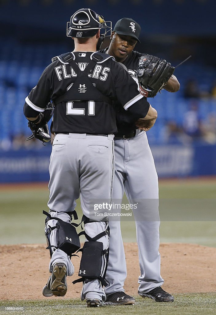 Tyler FLowers #21 of the Chicago White Sox celebrates their victory with Donnie Veal #46 during MLB game action against the Toronto Blue Jays on April 17, 2013 at Rogers Centre in Toronto, Ontario, Canada.