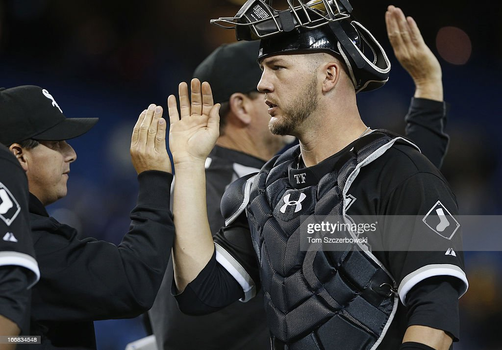 Tyler FLowers #21 of the Chicago White Sox celebrates with teammates after their victory against the Toronto Blue Jays in MLB game action on April 17, 2013 at Rogers Centre in Toronto, Ontario, Canada.