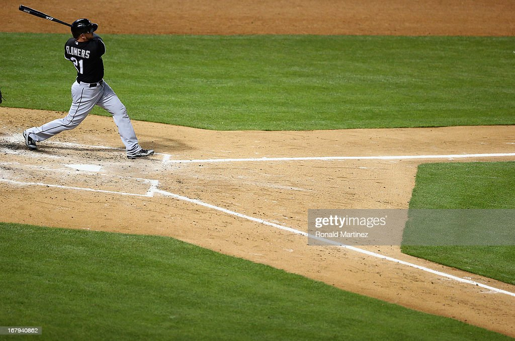 <a gi-track='captionPersonalityLinkClicked' href=/galleries/search?phrase=Tyler+Flowers&family=editorial&specificpeople=4217244 ng-click='$event.stopPropagation()'>Tyler Flowers</a> #21 of the Chicago White Sox hits a three-run homerun against the Texas Rangers at Rangers Ballpark in Arlington on May 2, 2013 in Arlington, Texas.