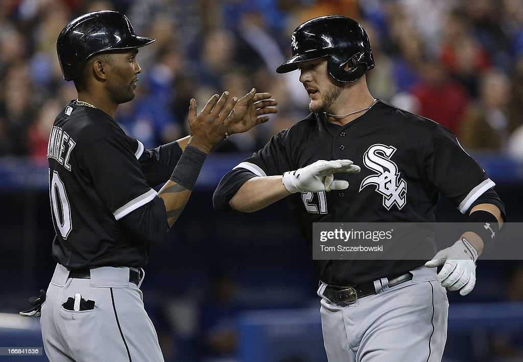 <a gi-track='captionPersonalityLinkClicked' href=/galleries/search?phrase=Tyler+Flowers&family=editorial&specificpeople=4217244 ng-click='$event.stopPropagation()'>Tyler Flowers</a> #21 of the Chicago White Sox is congratulated by <a gi-track='captionPersonalityLinkClicked' href=/galleries/search?phrase=Alexei+Ramirez&family=editorial&specificpeople=690568 ng-click='$event.stopPropagation()'>Alexei Ramirez</a> #10 after hitting a 3-run home run in the second inning during MLB game action against the Toronto Blue Jays on April 17, 2013 at Rogers Centre in Toronto, Ontario, Canada.