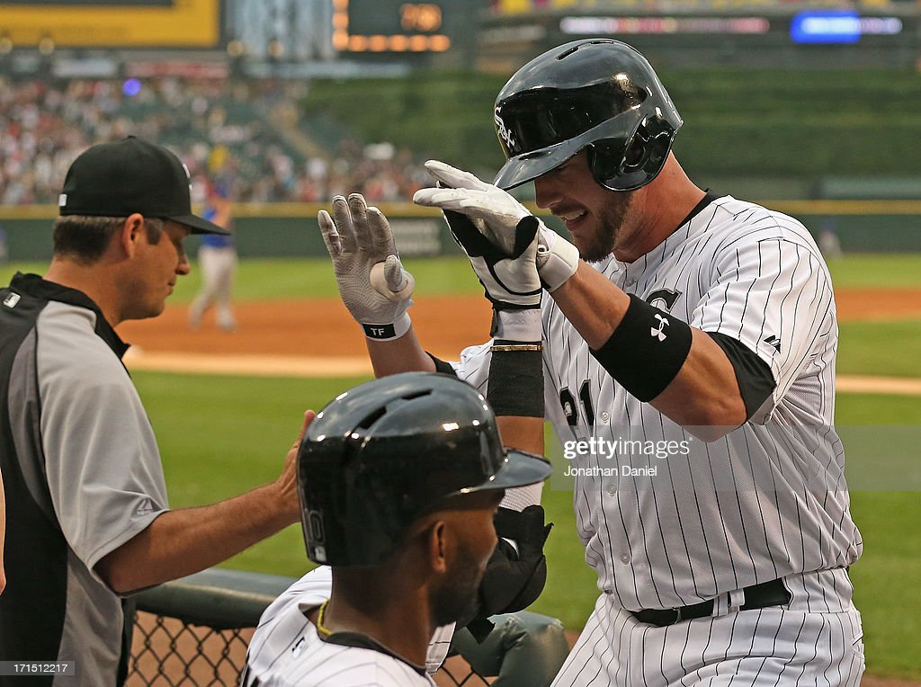 Tyler Flowers #21 of the Chicago White Sox is congratulated by manager Robin Venture #23 (L) and Alexei Ramirez #10 after hitting a solo home run in the 3rd inning against the New York Mets at U.S. Cellular Field on June 25, 2013 in Chicago, Illinois.