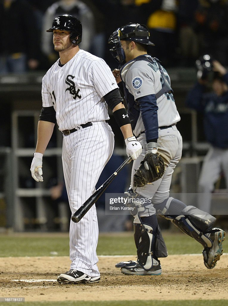 <a gi-track='captionPersonalityLinkClicked' href=/galleries/search?phrase=Tyler+Flowers&family=editorial&specificpeople=4217244 ng-click='$event.stopPropagation()'>Tyler Flowers</a> #21 of the Chicago White Sox stands on the field after striking out with the bases loaded to end the game as catcher Jesus Montero #63 of the Seattle Mariners stands behind him after the tenth inning on April 5, 2012 at U.S. Cellular Field in Chicago, Illinois. The Mariners won 8-7 in 10 innings.