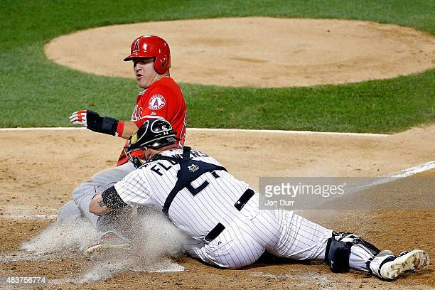 Tyler Flowers of the Chicago White Sox tags out Mike Trout of the Los Angeles Angels of Anaheim at home plate during the sixth inning at US Cellular...