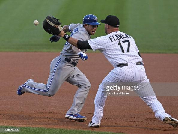 Tyler Flowers of the Chicago White Sox takes the throw on a rundown as Brett Lawrie of the Toronto Blue Jays tries to get past at US Cellular Field...