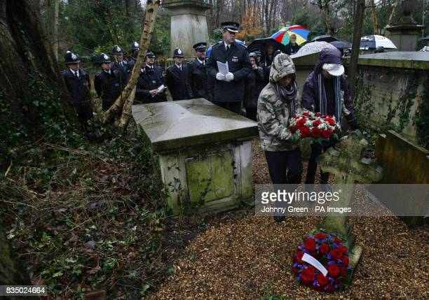 Tyler Forbes and his sister Quenelle both pupils at Earlsmead Primary School in Tottenham north London lay a wreath at the grave of Ralph Joscelyne...