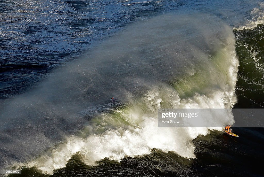 Tyler Fox competes during heat one of the Mavericks Invitational surf competition on January 20, 2013 in Half Moon Bay, California.