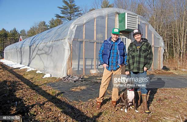 Tyler Gaudet and Jackson McLeod both of Portland stand with their fourlegged friend Addy outside the greenhouse in North Yarmouth where they run...