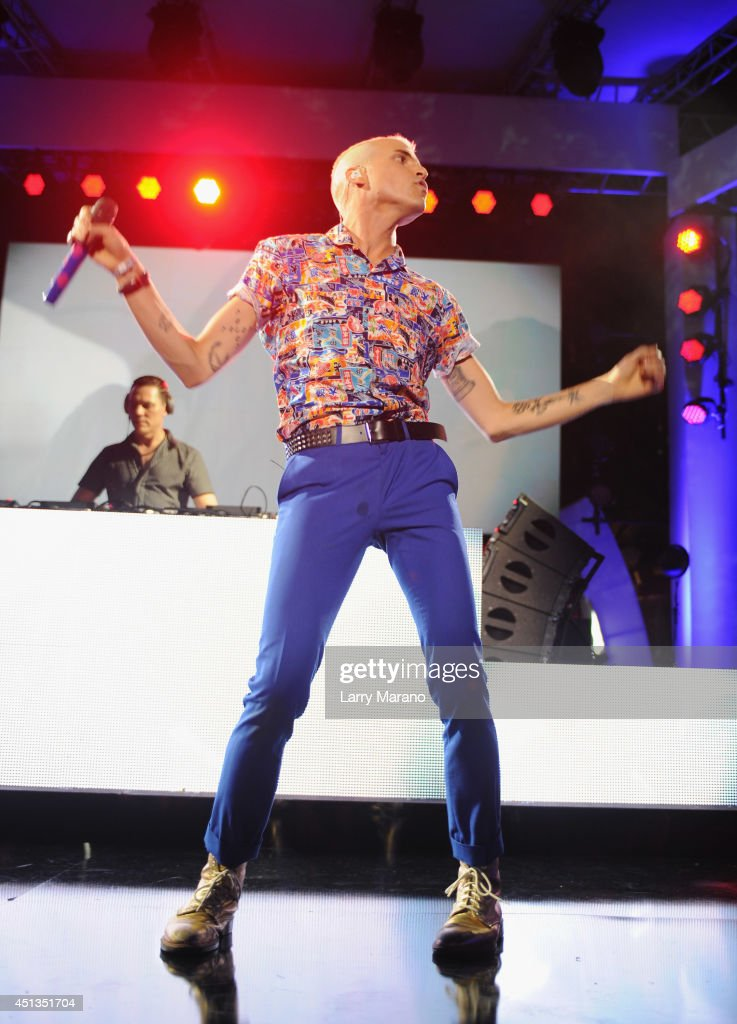 <a gi-track='captionPersonalityLinkClicked' href=/galleries/search?phrase=Tyler+Glenn&family=editorial&specificpeople=5680345 ng-click='$event.stopPropagation()'>Tyler Glenn</a> of Neon Trees (R) and <a gi-track='captionPersonalityLinkClicked' href=/galleries/search?phrase=DJ+Tiesto&family=editorial&specificpeople=2607549 ng-click='$event.stopPropagation()'>DJ Tiesto</a> (L) perform onstage at the iHeartRadio Ultimate Pool Party presented by VISIT FLORIDA at Fontainebleau's BleauLive at Fontainebleau Miami Beach on June 27, 2014 in Miami Beach, Florida.