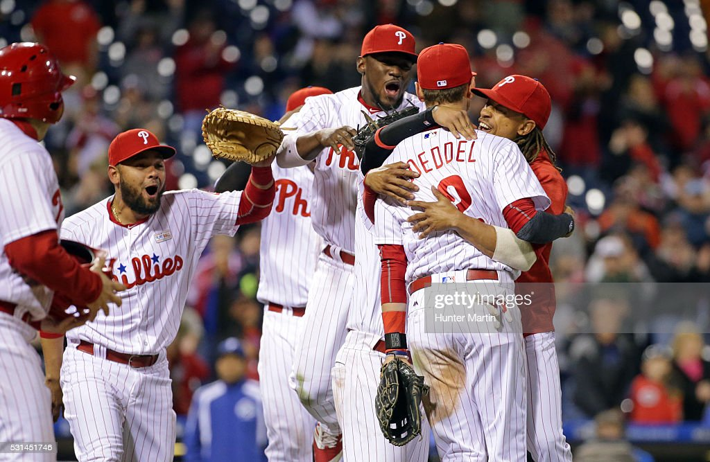 Tyler Goeddel of the Philadelphia Phillies is swarmed by teammates after his game saving throw to home plate in the ninth inning during a game...
