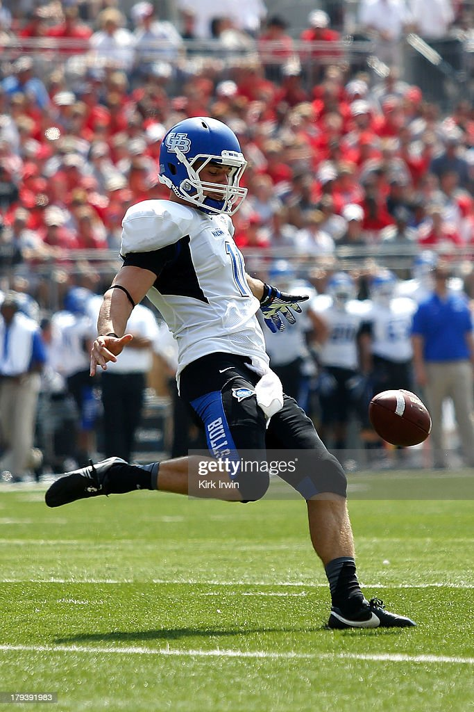 Tyler Grassman #11 of the Buffalo Bulls punts the ball during the game against the Ohio State Buckeyes on August 31, 2013 at Ohio Stadium in Columbus, Ohio. Ohio State defeated Buffalo 40-20.