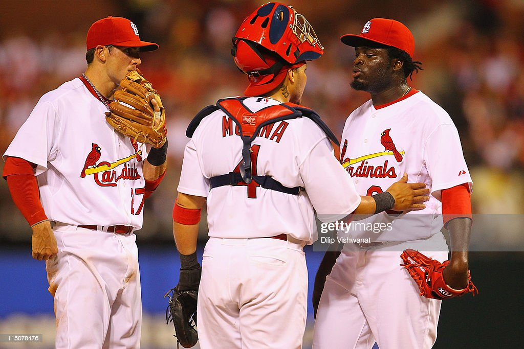 Tyler Greene #27 and <a gi-track='captionPersonalityLinkClicked' href=/galleries/search?phrase=Yadier+Molina&family=editorial&specificpeople=172002 ng-click='$event.stopPropagation()'>Yadier Molina</a> #4 both of the St. Louis Cardinals talk to Miekal Cleto #63 also of the St. Louis Cardinals against the San Francisco Giants at Busch Stadium on June 2, 2011 in St. Louis, Missouri.