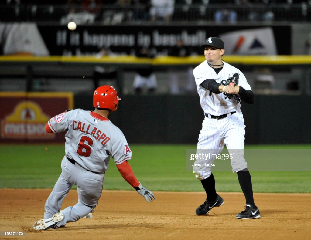 Tyler Greene #1 of the Chicago White Sox forces out <a gi-track='captionPersonalityLinkClicked' href=/galleries/search?phrase=Alberto+Callaspo&family=editorial&specificpeople=835933 ng-click='$event.stopPropagation()'>Alberto Callaspo</a> #6 of the Los Angeles Angels of Anaheim during the eighth inning on May 11, 2013 at U.S. Cellular Field in Chicago, Illinois.