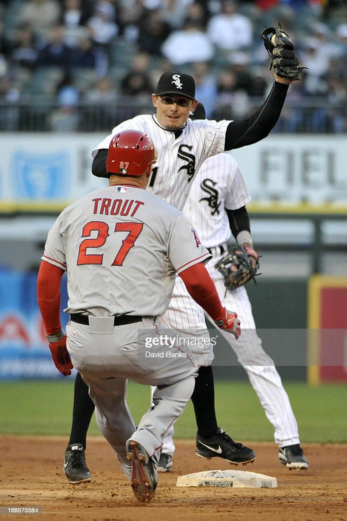 Tyler Greene #1 of the Chicago White Sox takes a throw and tags out <a gi-track='captionPersonalityLinkClicked' href=/galleries/search?phrase=Mike+Trout&family=editorial&specificpeople=7091306 ng-click='$event.stopPropagation()'>Mike Trout</a> #27 of the Los Angeles Angels of Anaheim during the third inning on May 11, 2013 at U.S. Cellular Field in Chicago, Illinois.