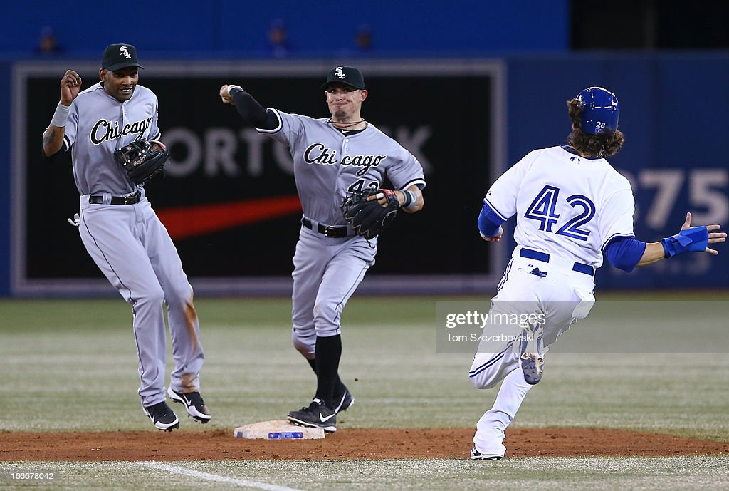 Tyler Greene of the Chicago White Sox turns a double play in the fifth inning as <a gi-track='captionPersonalityLinkClicked' href=/galleries/search?phrase=Alexei+Ramirez&family=editorial&specificpeople=690568 ng-click='$event.stopPropagation()'>Alexei Ramirez</a> reacts during MLB game and <a gi-track='captionPersonalityLinkClicked' href=/galleries/search?phrase=Colby+Rasmus&family=editorial&specificpeople=3988372 ng-click='$event.stopPropagation()'>Colby Rasmus</a> of the Toronto Blue Jays slides on April 15, 2013 at Rogers Centre in Toronto, Ontario, Canada. All uniformed team members are wearing jersey number 42 in honor of Jackie Robinson Day.